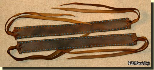 A pair of buckskin legging garters in an 18th-century style