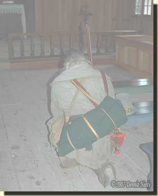 Kneeling to pray at St. Anne's Church, Fort Michilimackinac.