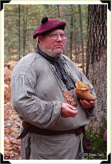 A traditional woodsman watches a trail.