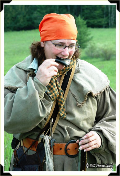 A traditional lady of the woods loading a Chief's grade trade gun.