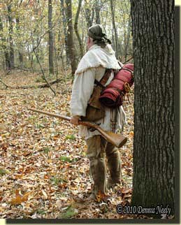 Dennis Neely, a traditional woodsman, contemplating turning south.