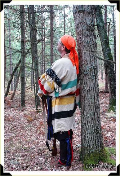 Traditional woodsman Joe Brown keeping an eye on a black squirrel.