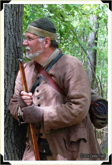 TradBritish Ranger Darrel Lang leaning against a red oak tree.