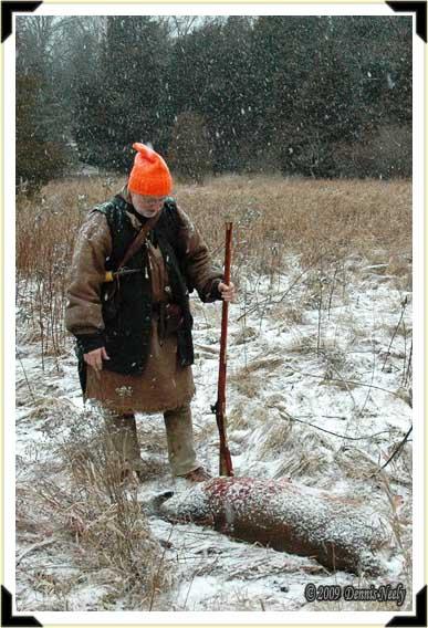 Jon Hollenbeck standing over a fresh-killed doe.
