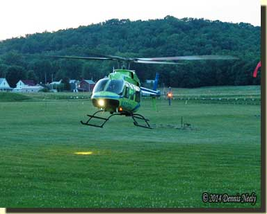 StatFlight medical helicopter landing on the silhouette range.