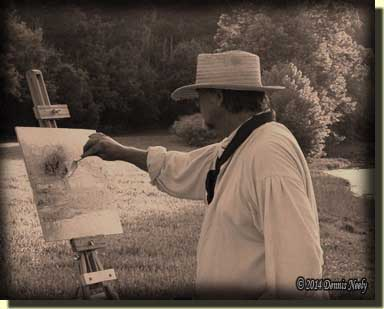 Living historian Lon Brauer painting in 19th-century clothing.