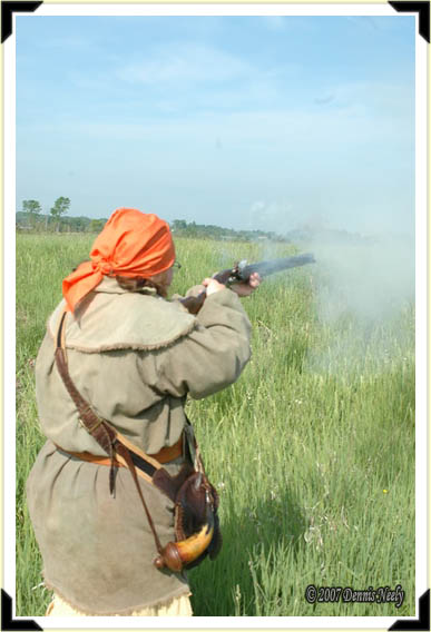A lady of the woods peers through a smoke cloud from her flintlock.