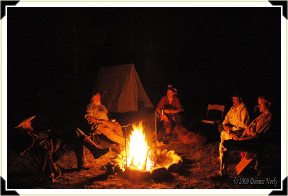 Traditional woodsmen sharing stories around a campfire.