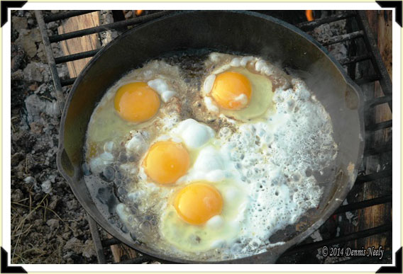 Eggs frying in a cast iron skillet