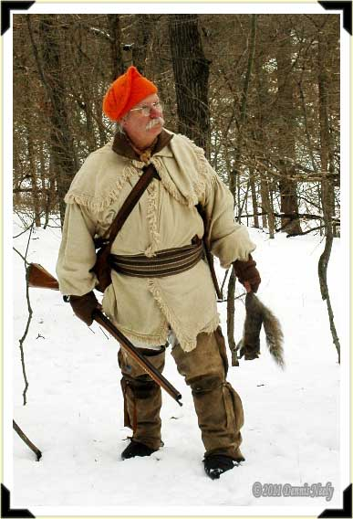 A traditional woodsman with a grey squirrel.
