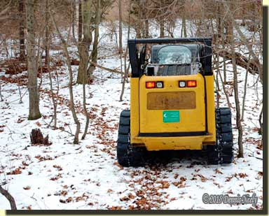 A Caterpillar 299C Multi-Terrain track loader following the deer trail.