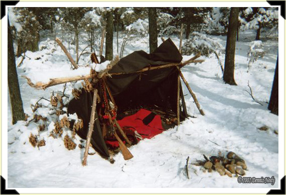A one woodsman winter lean-to after a fresh snowfall.