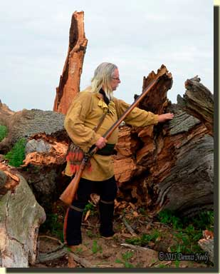 A traditional woodsman touching a huge red oak tree.