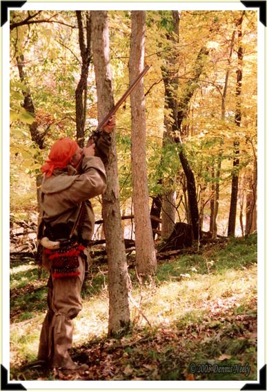 A traditional woodsman aiming at a squirrel in a tree.