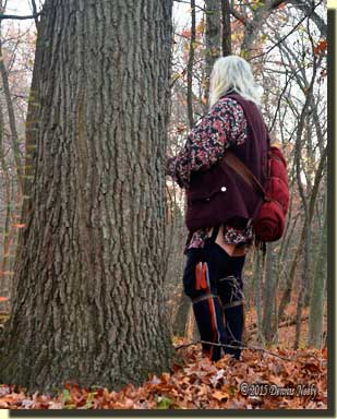 A woodsman with a bedroll bound by a portage collar.
