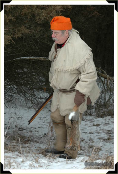 An 18th-century trading post hunter follows rabbit tracks in the snow.follow