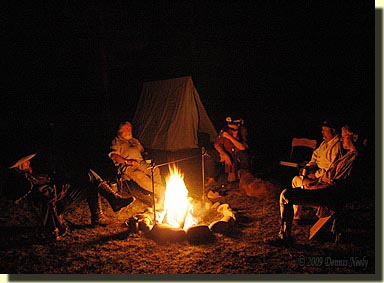 Traditional woodsmen swapping tales around an evening fire.