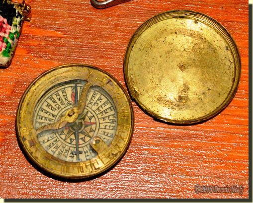 "A brass compass made ""prior to 1850."""