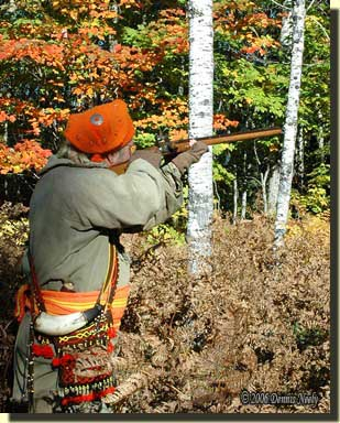 A traditional woodsman taking aim.