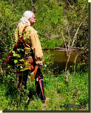 A traditional woodsman beside the Pigeon River.