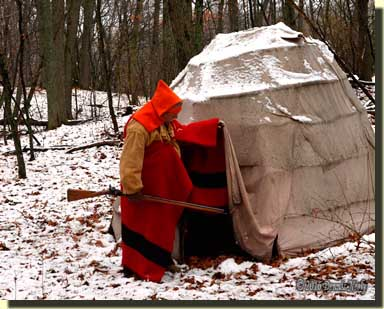 The returned white captive pulls aside the flap to the snow-covered wigwam