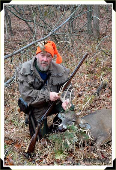A traditional woodsman with a fine buck.