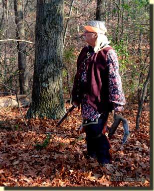A returned white captive hunter watches three fox squirrels on a far knob.