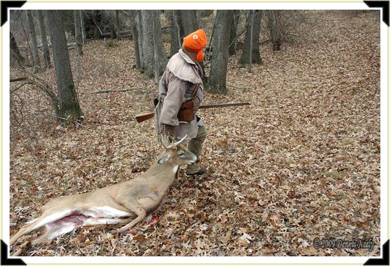 A hunter for a North West Company post dragging a fine buck back to camp.