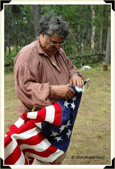 David Graham attaches 'Old Glory' to the camp flag pole.