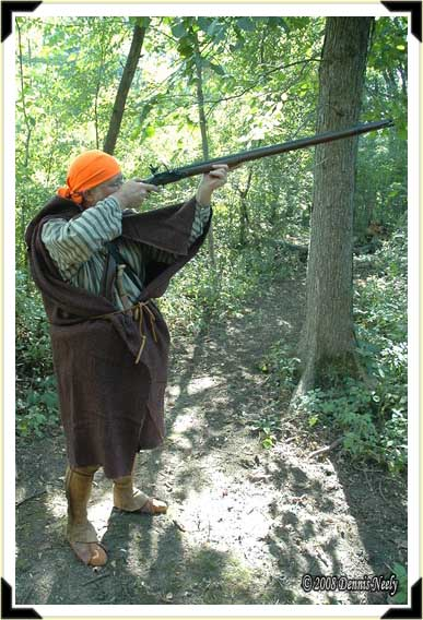A French woodsman takes careful aim at a fox squirrel.