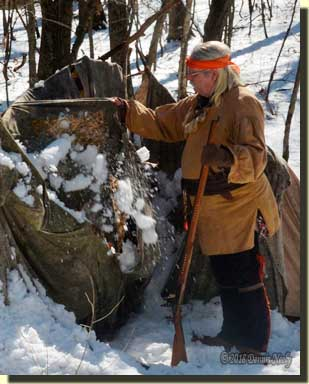 Msko-waagosh trying to shake frozen snow off the broken wigwam.