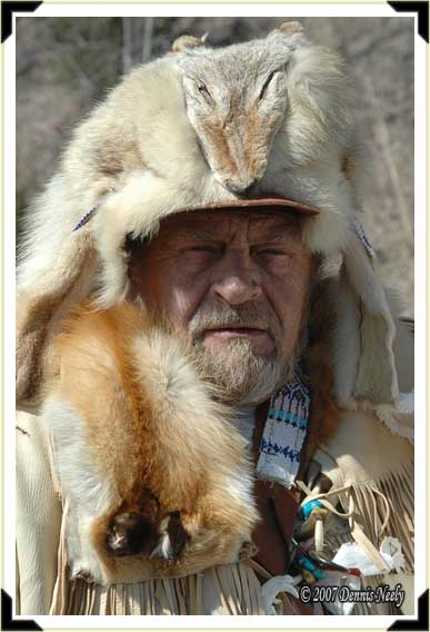 A grizzled mountainman in a fur cap.