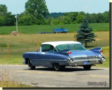 Uncle Jerry's '59 Cadillac on the road.