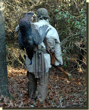 A tradtional woodsman with a plump wild turkey.