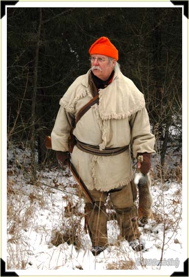 A traditional woodsman looks to the south with concern on his face...
