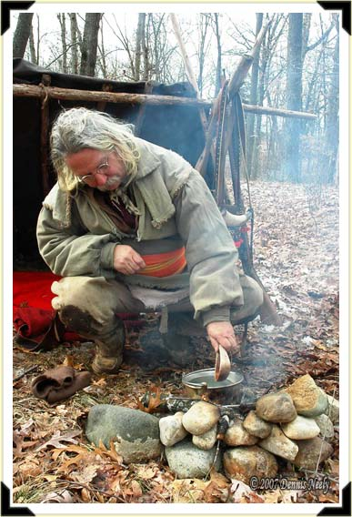 A trading-post hunter boils water in a brass kettle.