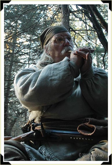 A traditional woodsman clucks twice with a wing bone call.