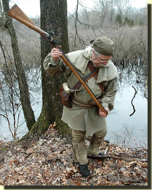 The hired hunter sloshing water in the bore of his Northwest trade gun.
