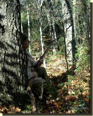The trading post's hired hunter sits behind an oak tree waiting for the wood ducks to return.