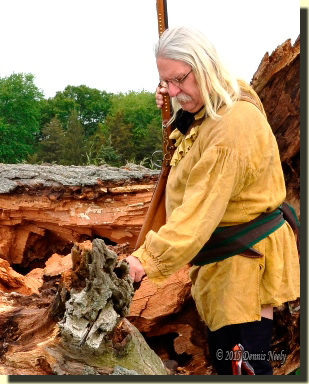 Msko-waagosh touches what remains of a favorite red oak tree.