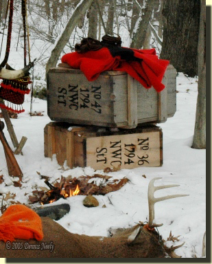 "Two crates, No. ""36"" and ""47"" sit in the snow at the post hunter's winter camp."