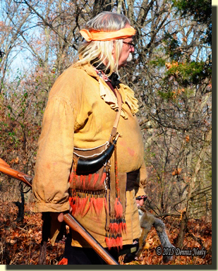 Msko-waagosh's shot pouch, horn and split belt pouch shown during a squirrel hunt.