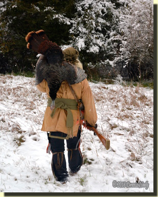 Msko-waagosh, called Red Fox in the English tongue, walks through a snowy wilderness with a wild turkey slung over his shoulder.